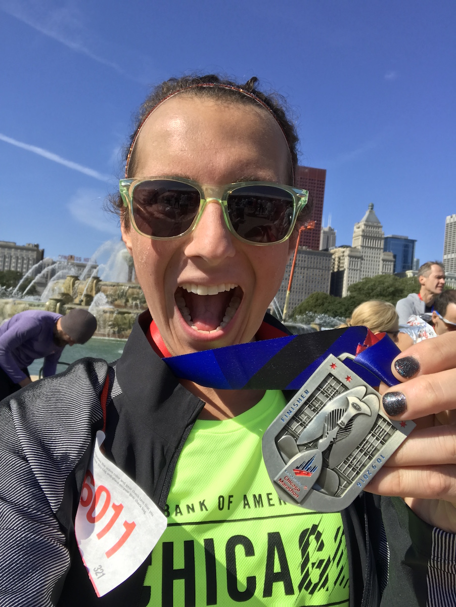Amelia Gapin with 2016 Chicago Marathon medal in Grant Park
