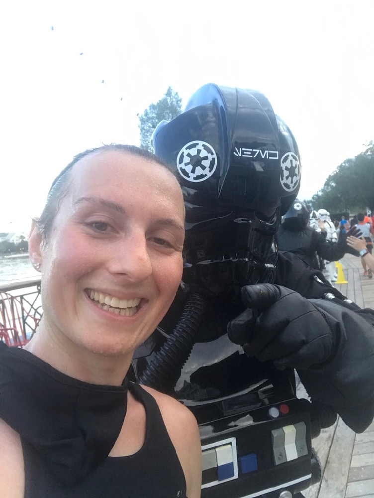 Amelia with tie fighter pilot at runDisney Star Wars Dark Side Half Marathon