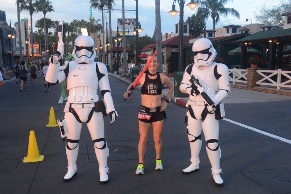 Amelia with stormtroopers at runDisney Star Wars Dark Side Half Marathon