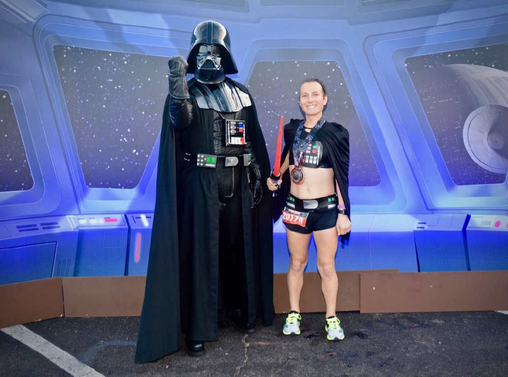 Amelia with Darth Vader at runDisney Star Wars Dark Side Half Marathon